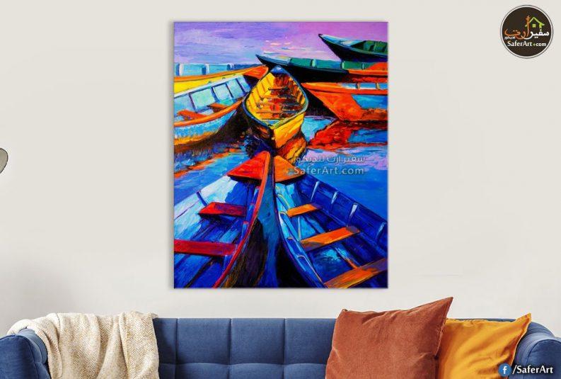 لقوارب نيليه صغيره باللون الازرق والبرنقالى والاحمر