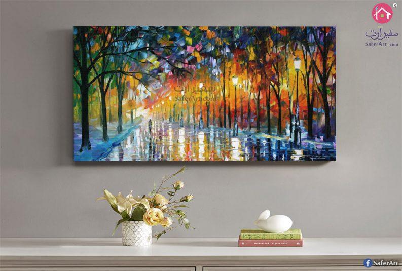 تابلوه حائط مميز لطريق به بعض الاشجار الكثيفه الملونه بالوان مختلفه وزاهيه