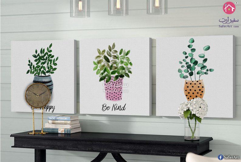 تابلوه لمجموعه من النباتات والزهور الموضوع داخل اصيص