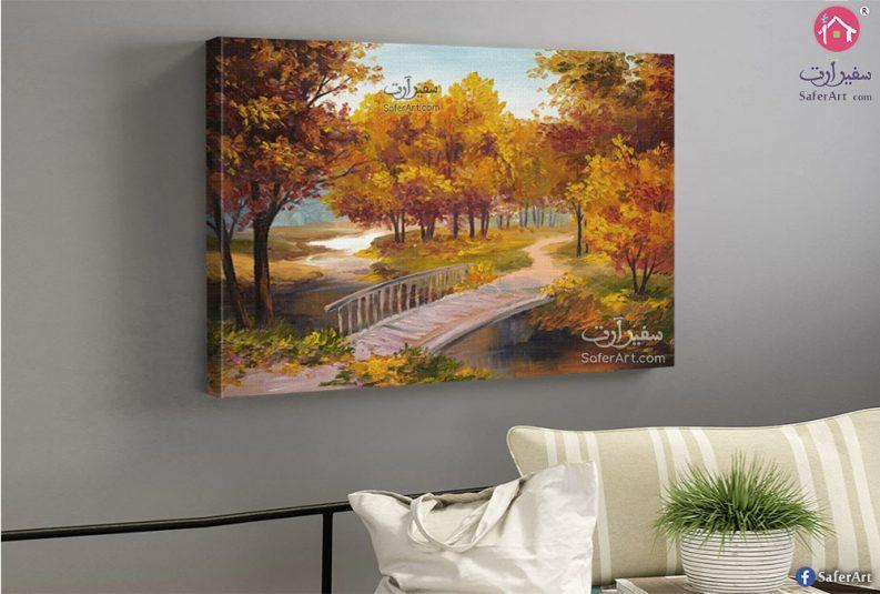 لحديقه بها اشجار عديده ملونه باللون الاصفر على جانبى ممر